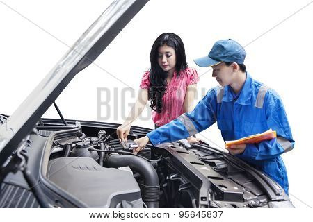 Mechanic Checking The Car Machine With The Owner