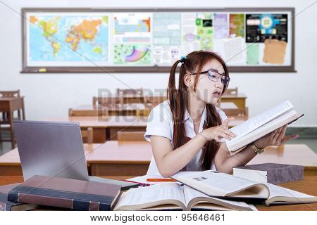 Teenage Student Studying In Class Seriously