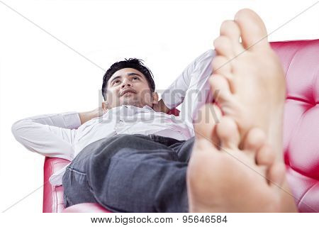Thoughtful Man Relaxing On Couch
