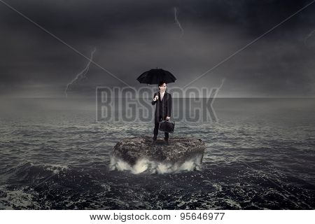 Worker Standing On The Sea Over The Rock