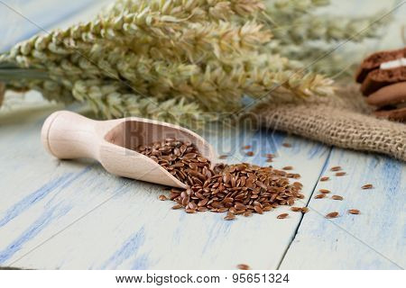 Linseeds Near Wooden Spoon On Blue Board