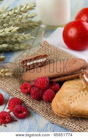 Several Raspberries Cereal Biscuits On Jute