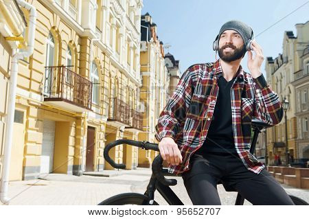 Attractive happy man is relaxing in city