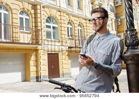 Attractive styled man is traveling across city
