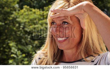 Pretty Mature Woman Looking Faraway