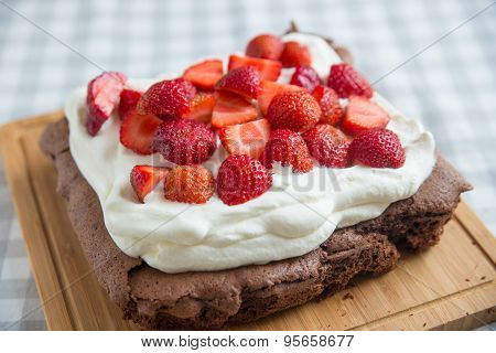 Chocolate Brownie with clotted cream and strawberries
