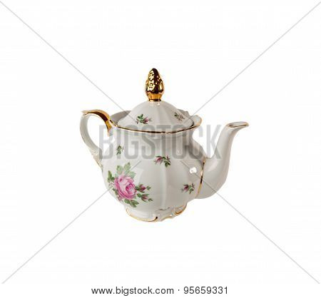 Porcelain teapot with ornament of roses and gold in classic style isolated on white