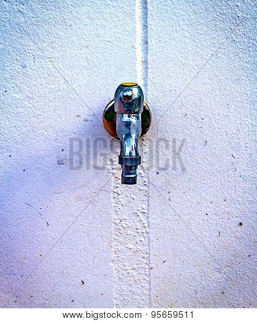 Old Water Tap On The Concrete Wall