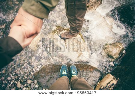 Feet Couple Man and Women in love holding hands hiking
