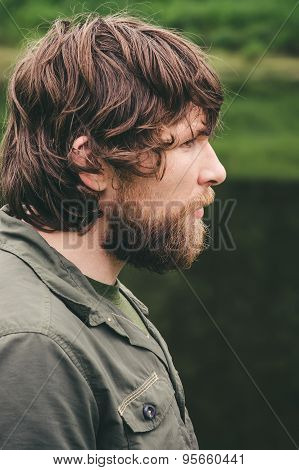 Young Man bearded curly hair portrait outdoor