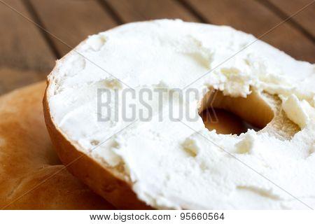Cream cheese plain bagel.