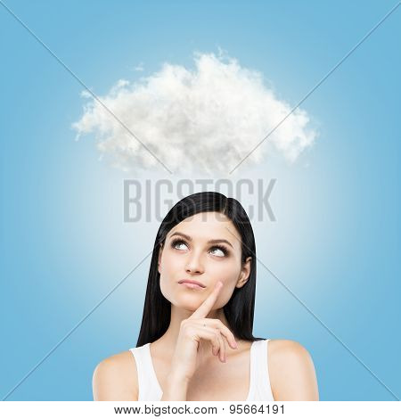 A Portrait Of A Pensive Brunette Lady In A White Tank Top. A Cloud Is Hanging Above The Head. Blue B