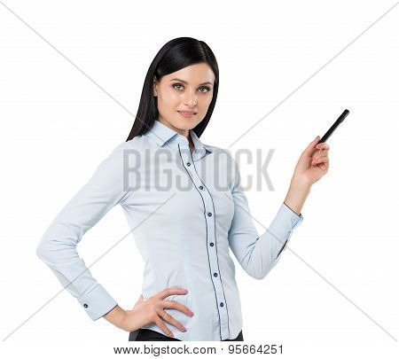 A Brunette Is Pointing Out The Copy Space. Isolated.