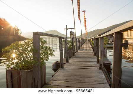 Wood Bridge On Leak And Houseboat ,sunlight