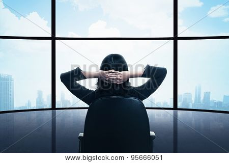 Business Woman Sitting On The Chair Looking The Window