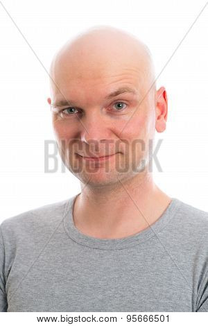 Young Man With Bald Head  Is Smiling In To The Camera