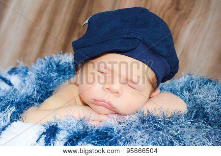 Newborn sleeping tasty beret