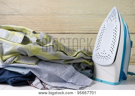 Pile Of Clothes With Iron