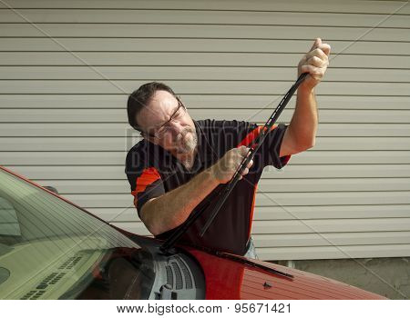 Mechanic Replacing Wiper Blades On A Car