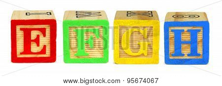 E F G H toy wooden letter blocks