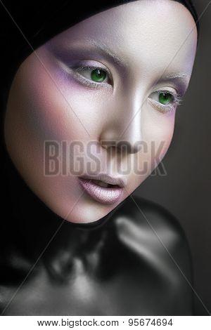 Portrait Of A Mysterious Woman With A Fantastic Makeup Alien With Green Eyes