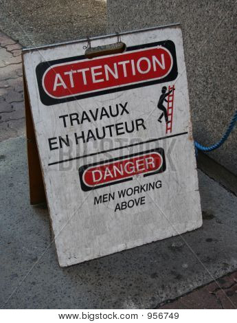 Bilingual Danger Men Working Above Sign