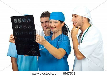 Team Of Doctors Examine A Magnetic Resonance