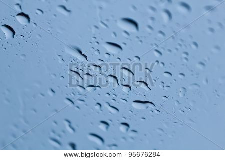 Rain Drops On A Window Or Water Drops On Grass