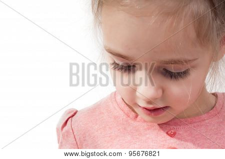 Closeup shot of little girl with long eyelashes
