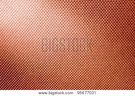 Orange Fabric Nylon Background Texture With Light From Corner