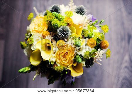 Close up of bridal wedding yellow bouquet