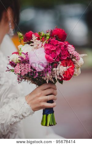 Bride holding bright wedding colorful bouquet