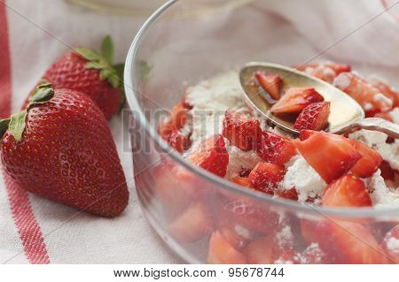 Bowl of chopped strawberries with flour