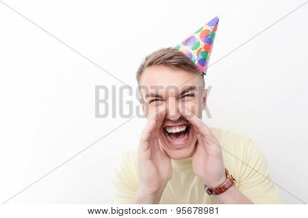 Close-up of crazy man wearing birthday hat