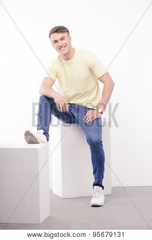 Young handsome man posing on isolated background