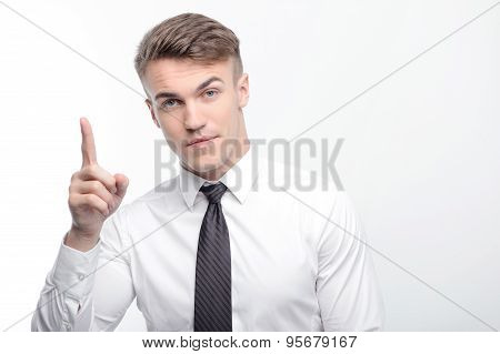 Businessman pointing with his index finger