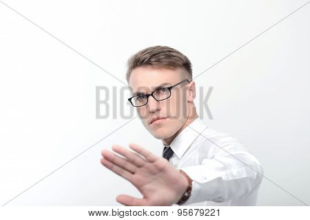 Angry businessman pointing with his hand