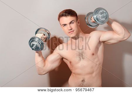 Portrait of man with barbell
