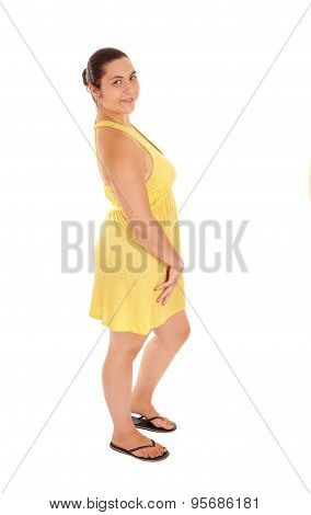 Standing Woman In Yellow Dress.