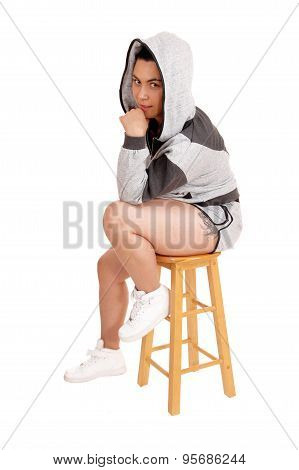 Girl Sitting In Hoodie On A Chair.