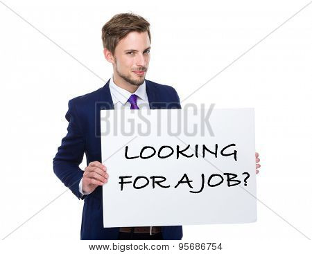 Businessman hold with white board showing phrase of looking for a job