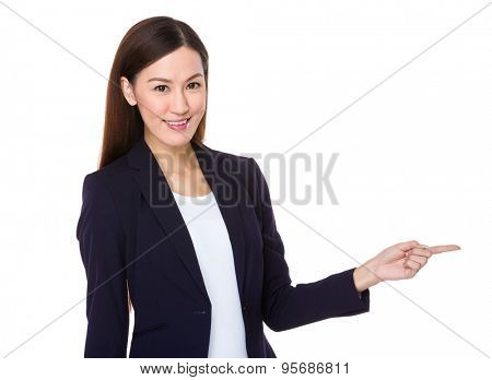 Beautiful Businesswoman showing finger point aside