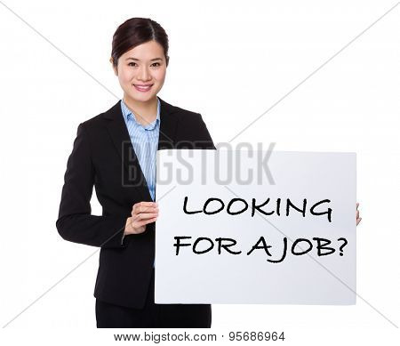 Businesswoman showing a white board with phrase of looking for a job