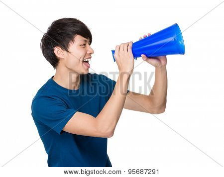Young man yell with loudspeaker
