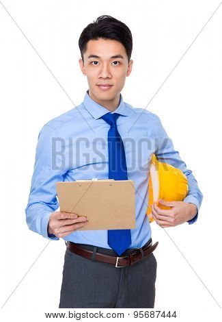 Engineer with clipboard and yellow helmet