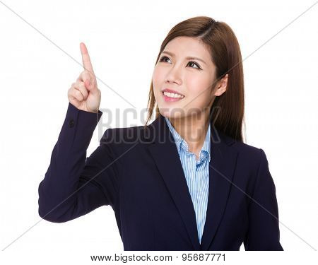 Young businesswoman look at the finger touch on the imaginary panel
