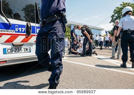 Police Arresting Man During Protest