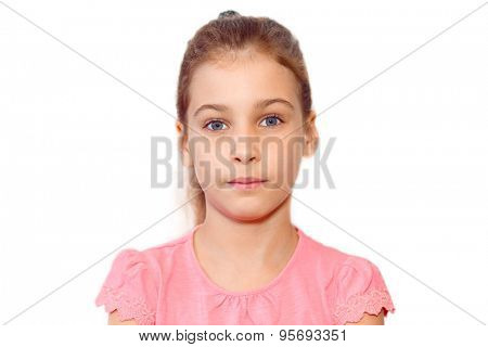 Portrait of teen girl without emotions in pink blouse isolated on white background