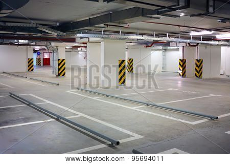 Interior underground parking for car, located under house, residential building