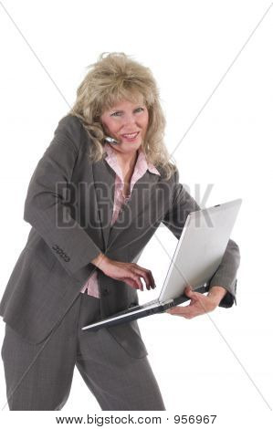 Business Woman Multitasking With Cellphone And Laptop 5